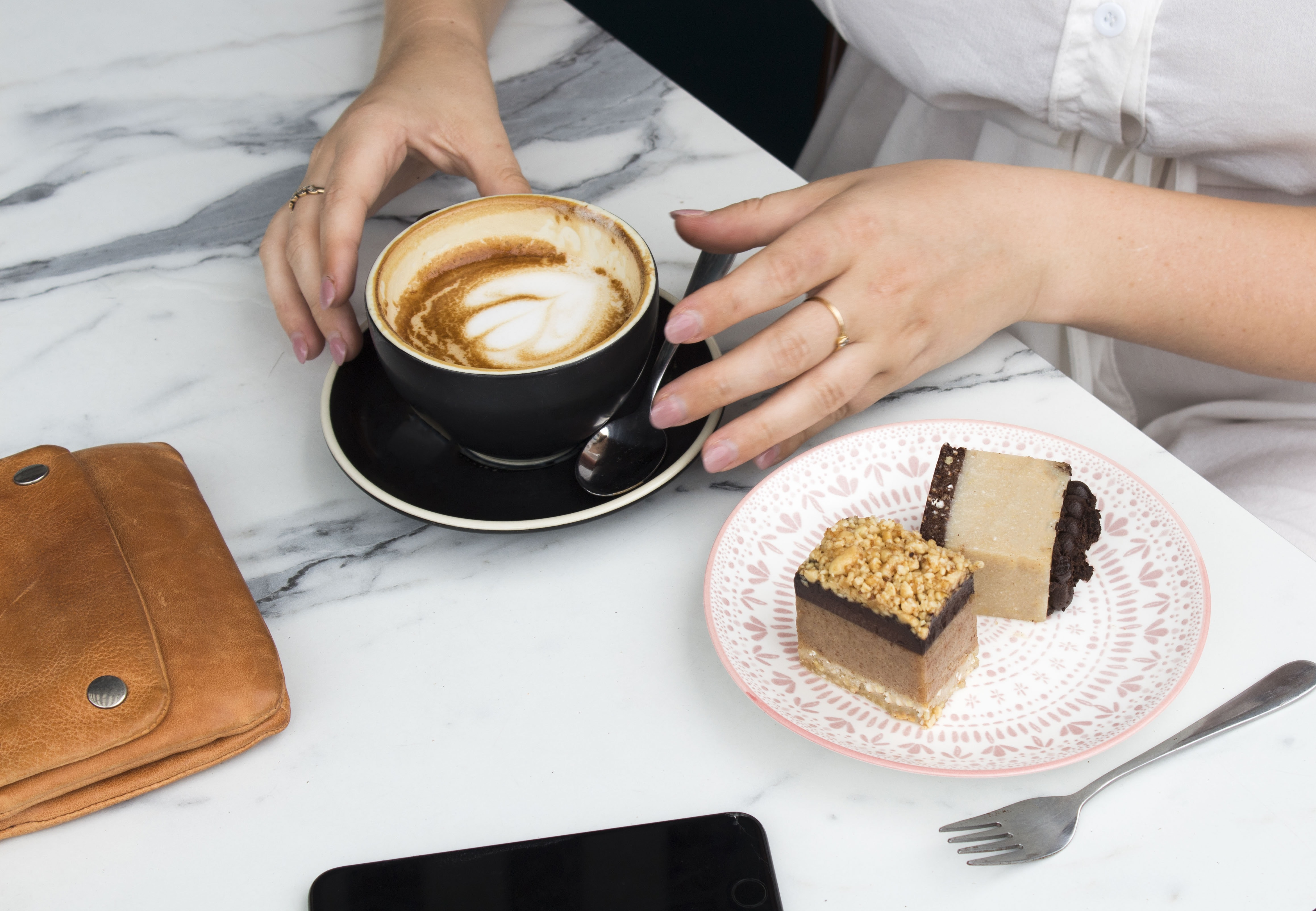 woman drinking coffee in cup beside table