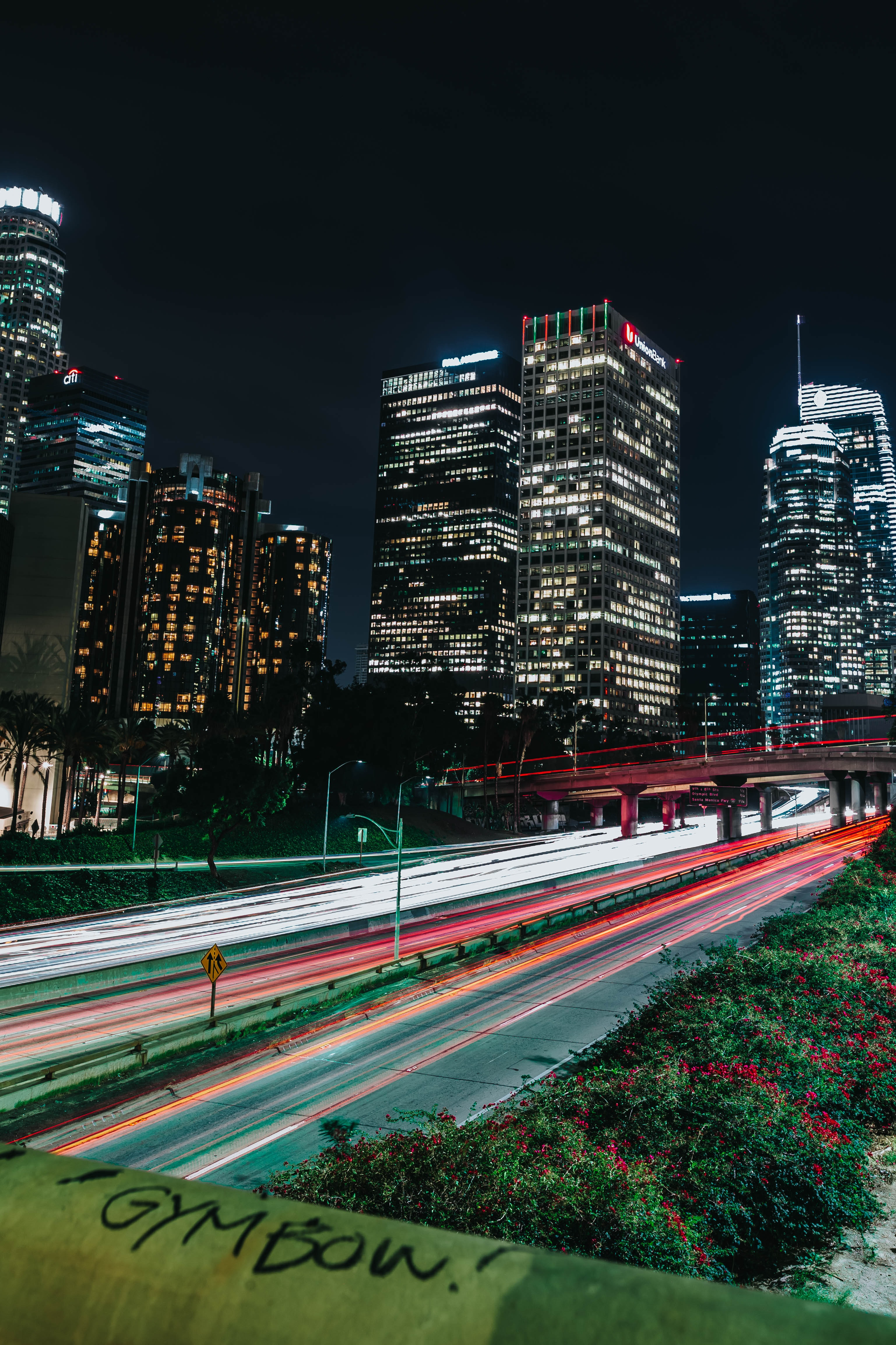 time lapse photography of buildings and road at night