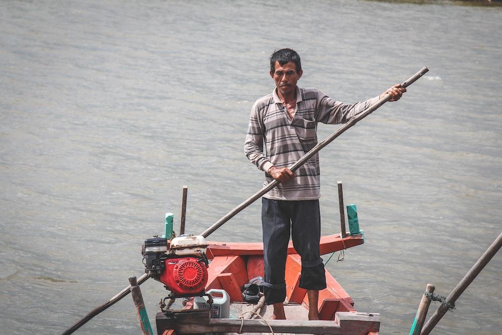 man riding on boat