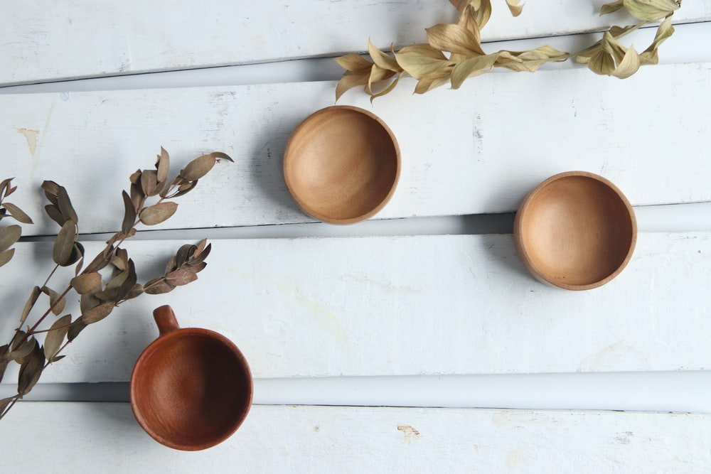 empty mug and saucers