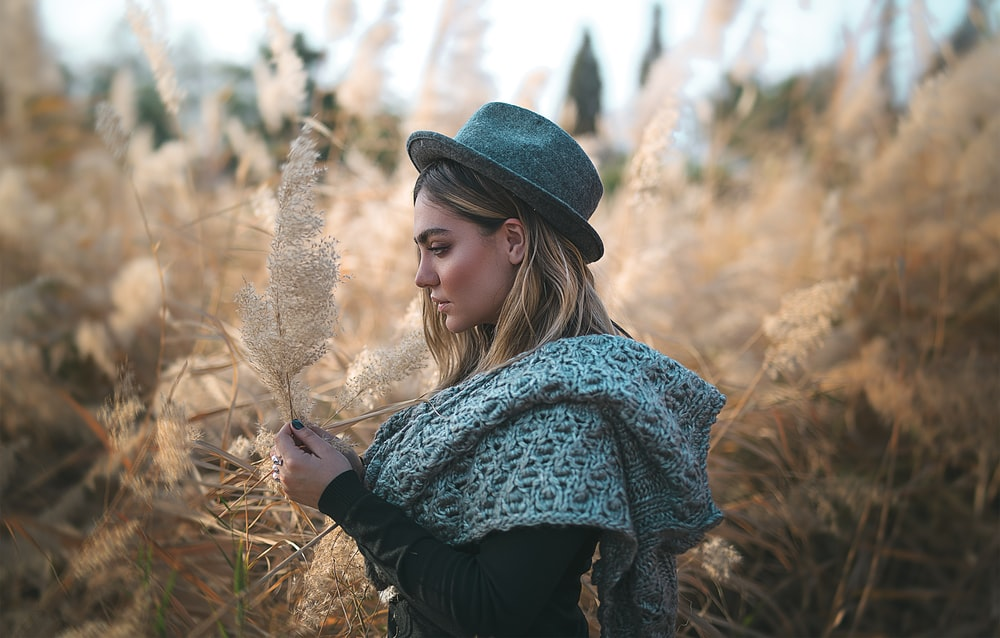 woman standing near field