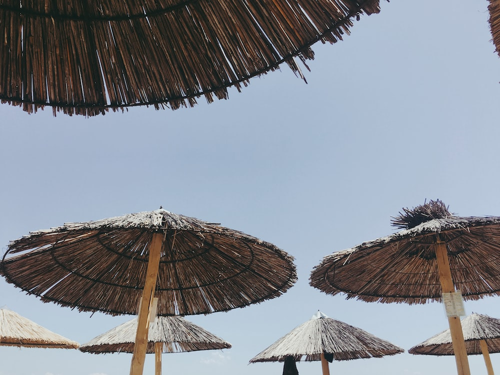 wooden parasols under clear sky