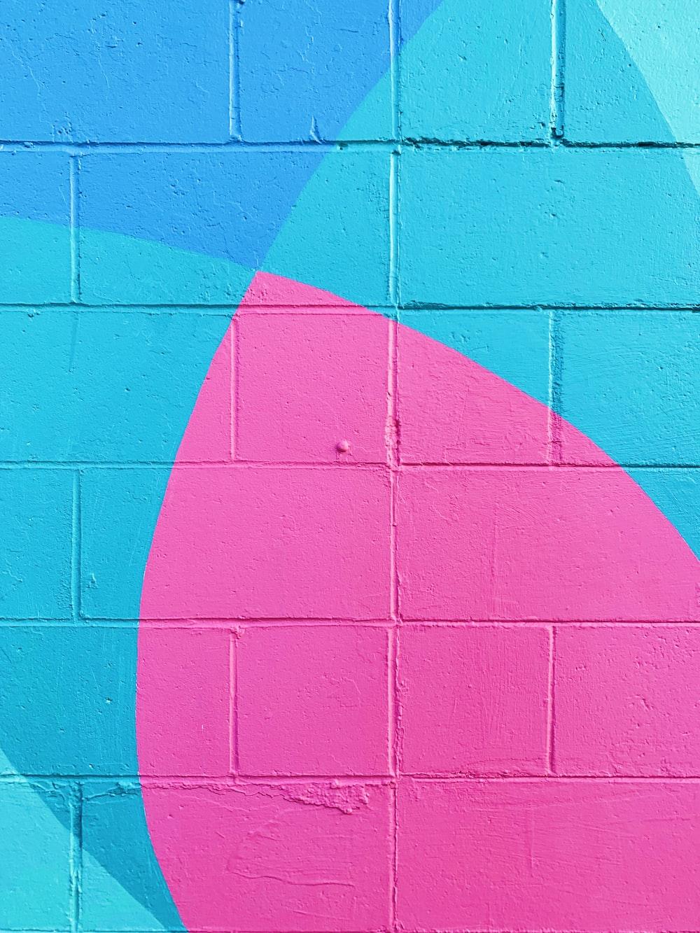 closeup photo of teal and pink wall