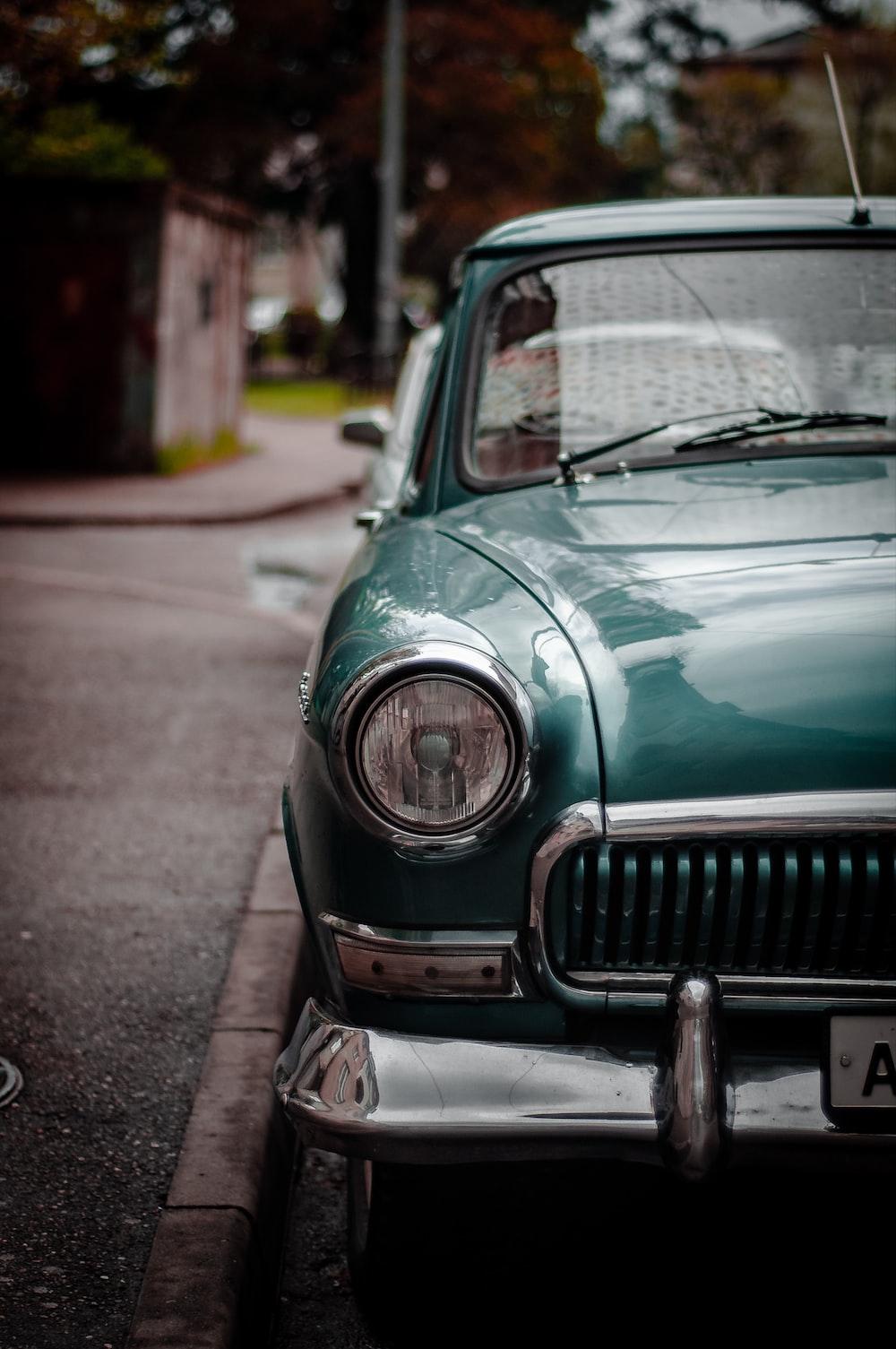 Vintage Green Vehicle Parked On Sidewalk Photo Free