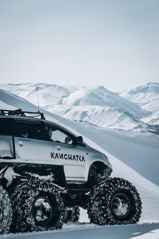 grey vehicle on mountain