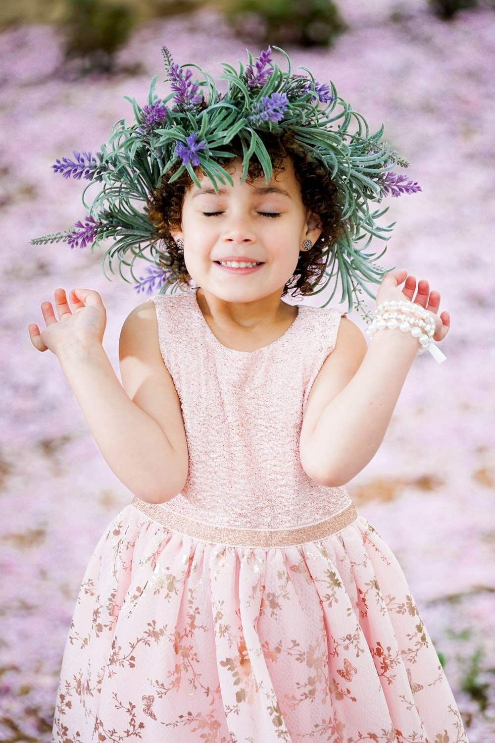girl wearing pink dress and flower wreath