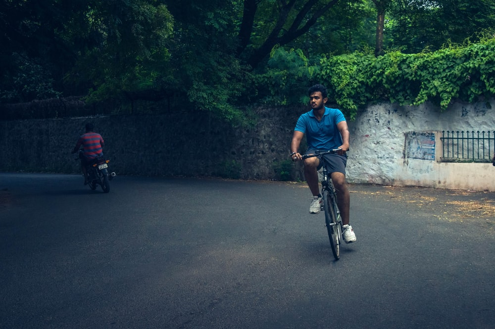man cycling on road