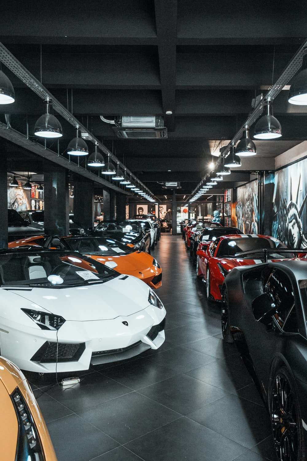 different luxury cars parking inside building