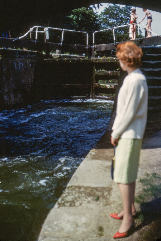 woman standing near pool