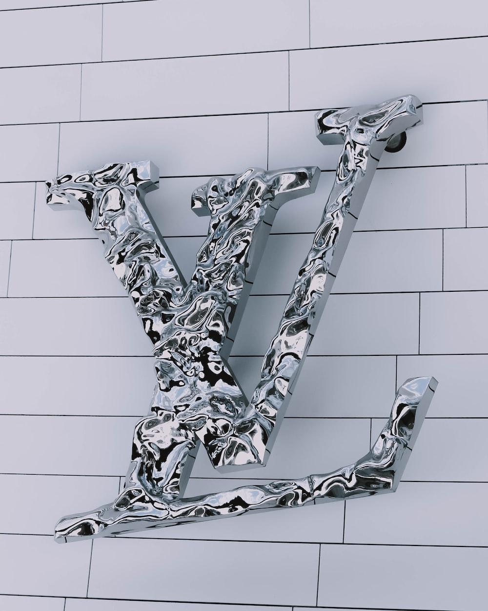 gray and white Louis Vuitton logo