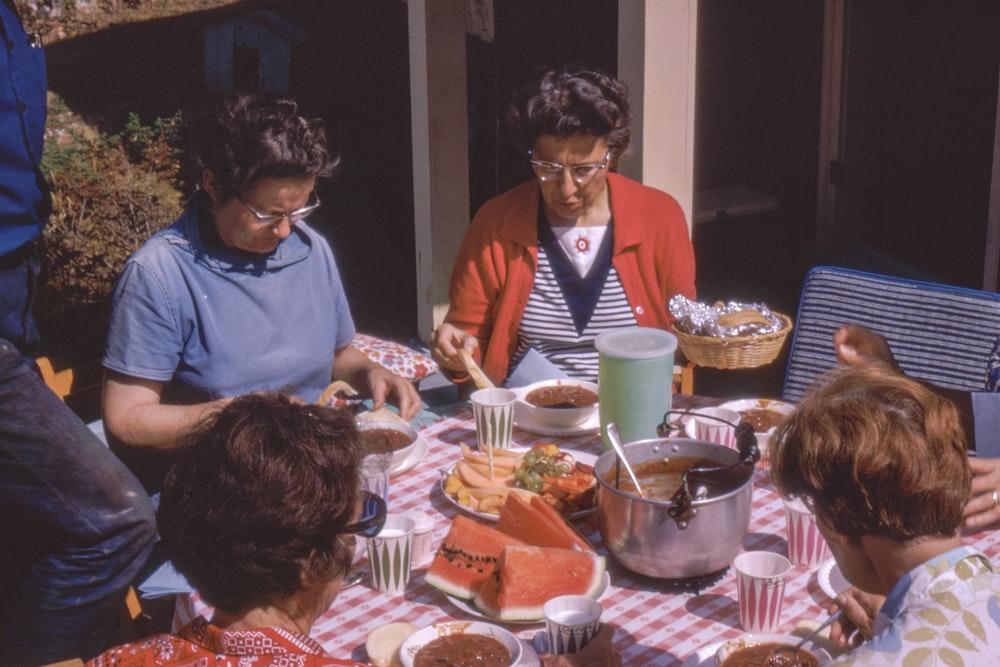 women sitting beside table