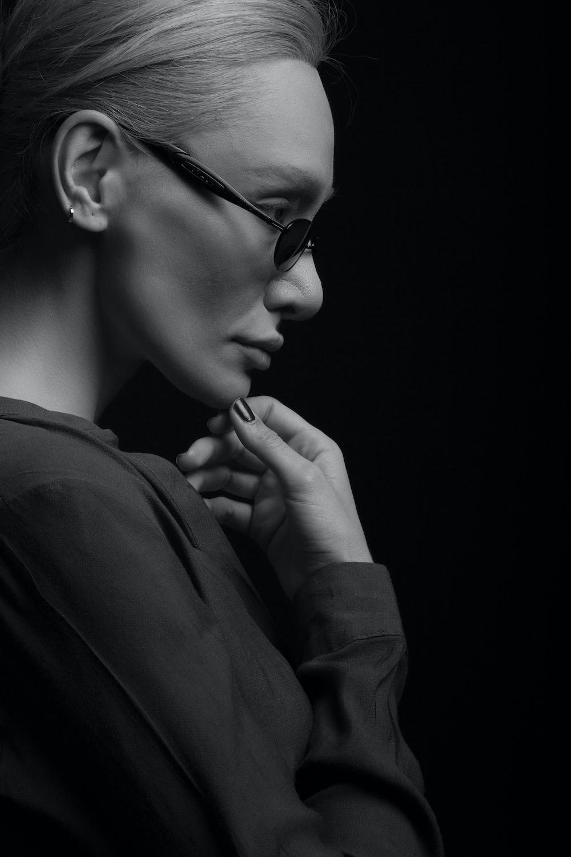 woman in long-sleeved top wearing sunglasses