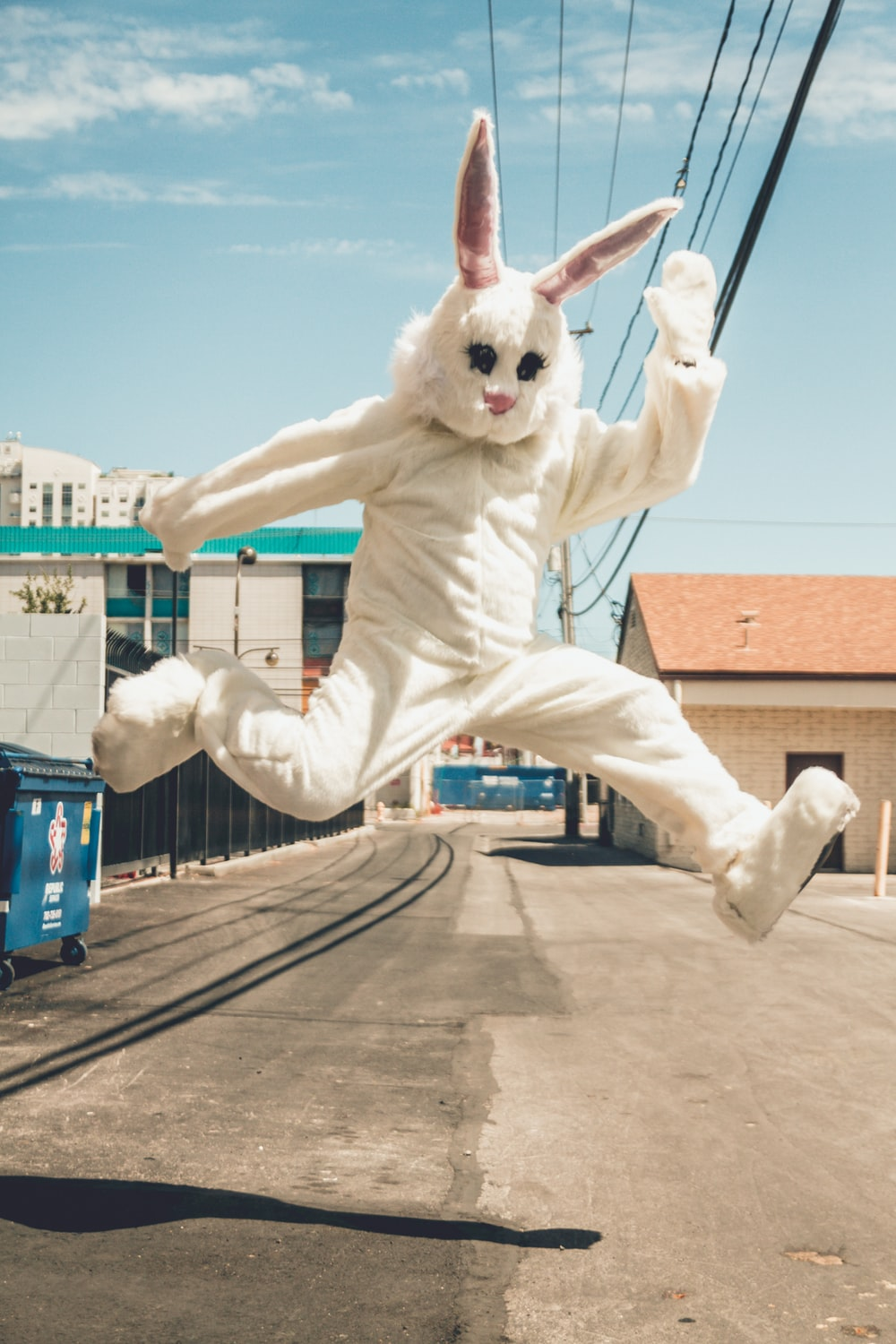 man in bunny costume in mid air in time lapse photography