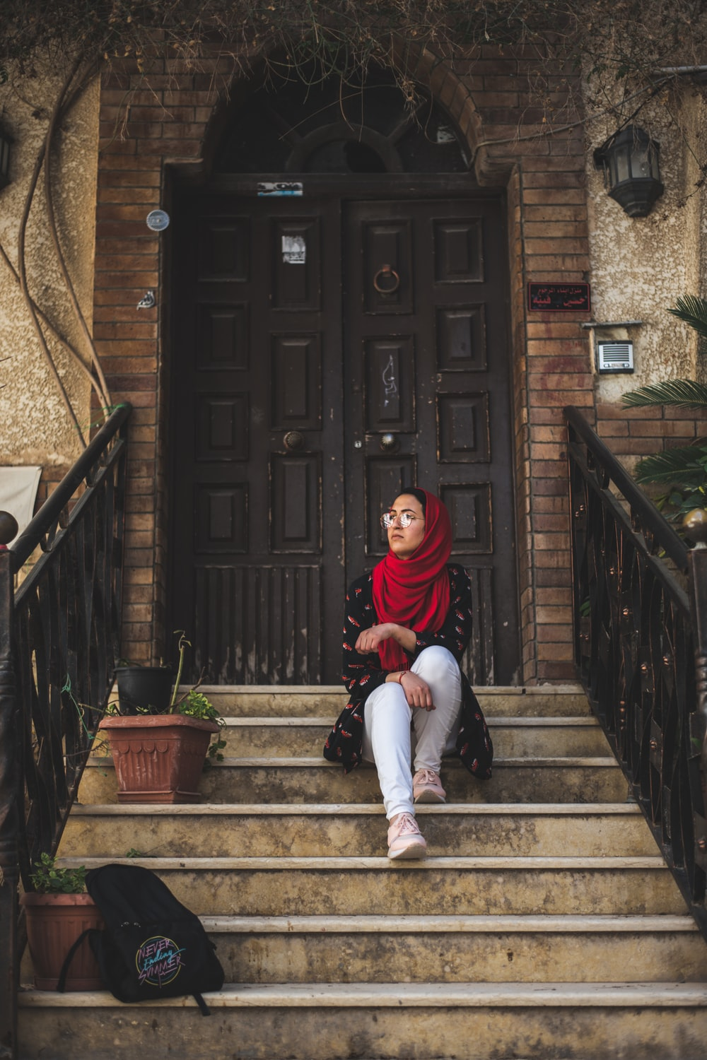 woman sitting on staircase during daytime