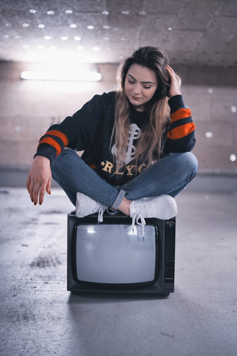 woman seated on TV