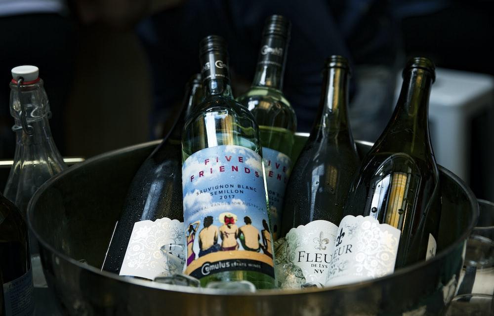 blue labeled bottles in bucket