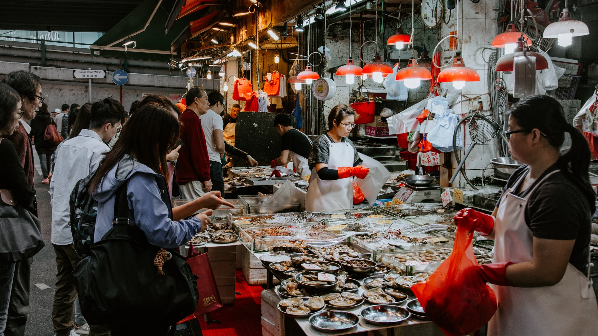Early morning scene at a market in Hong Kong. This particular stall was selling seafood - it was interesting to see as this was in an alley that is close to tall buildings and housing area. So there were also a lot of people heading to work.