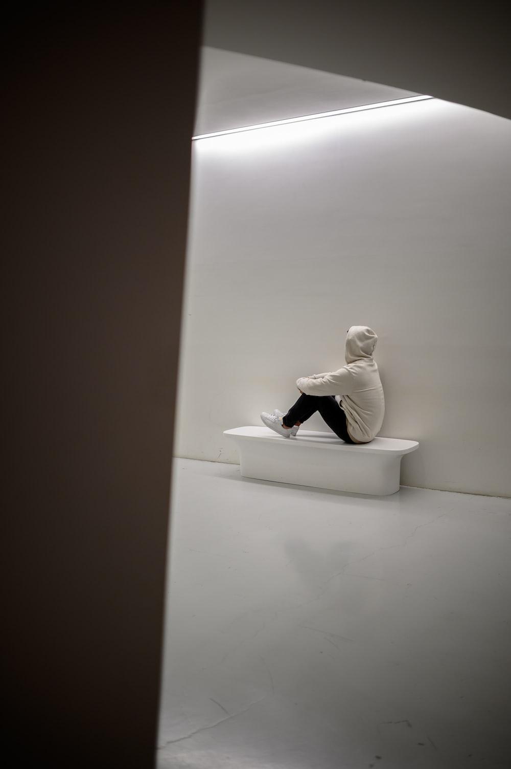 man sitting on white floor