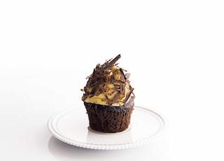 brown and white cupcake on round white ceramic plate