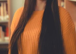 woman standing wearing black hat