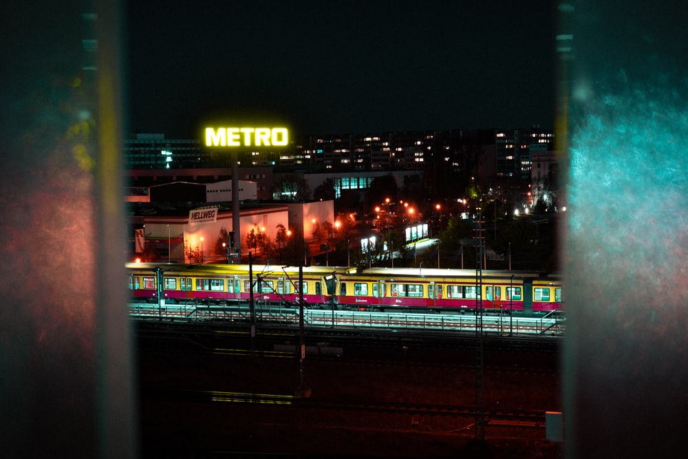 aerial photography of light rail system at night