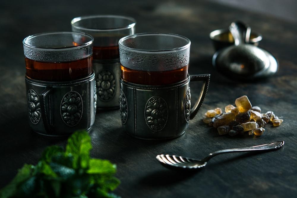 three clear glass mugs with brown liquid