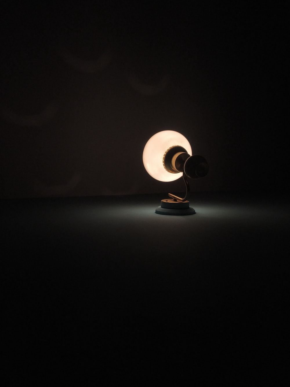 turned-on table lamp