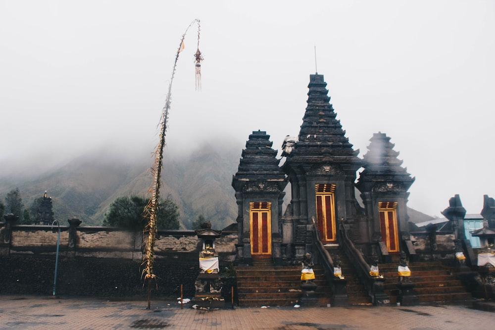 gray concrete shrine on foggy daytime