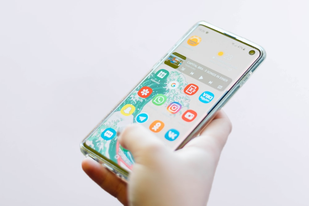 person using silver Android smartphone