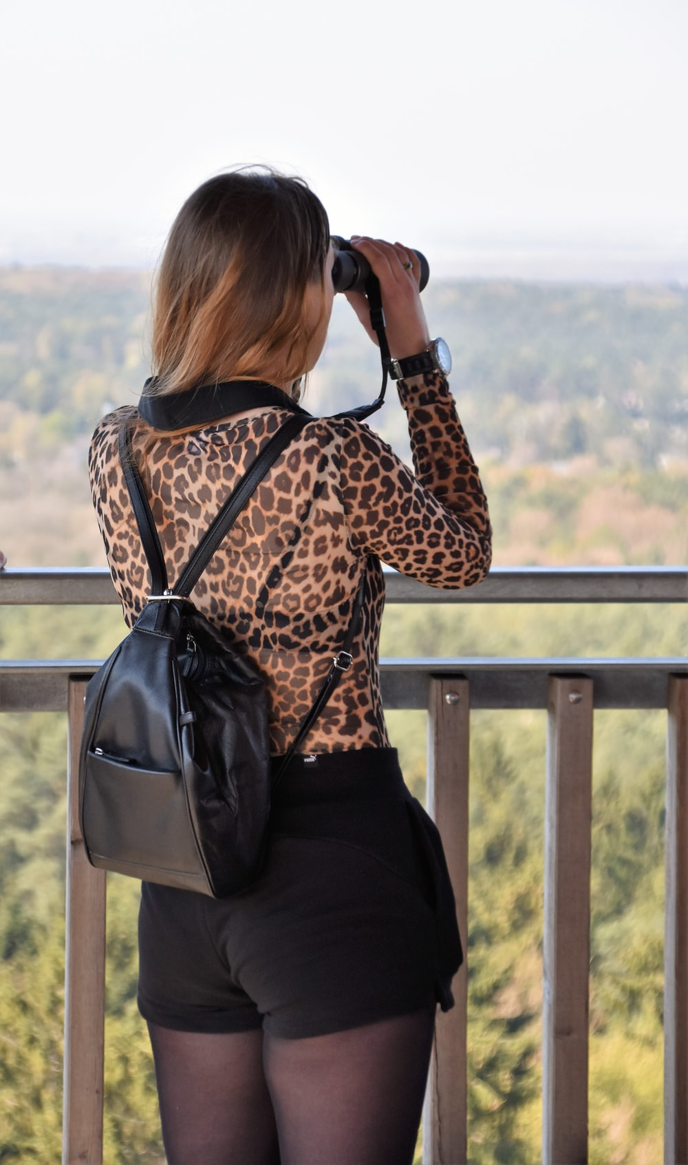 woman looking on binoculars
