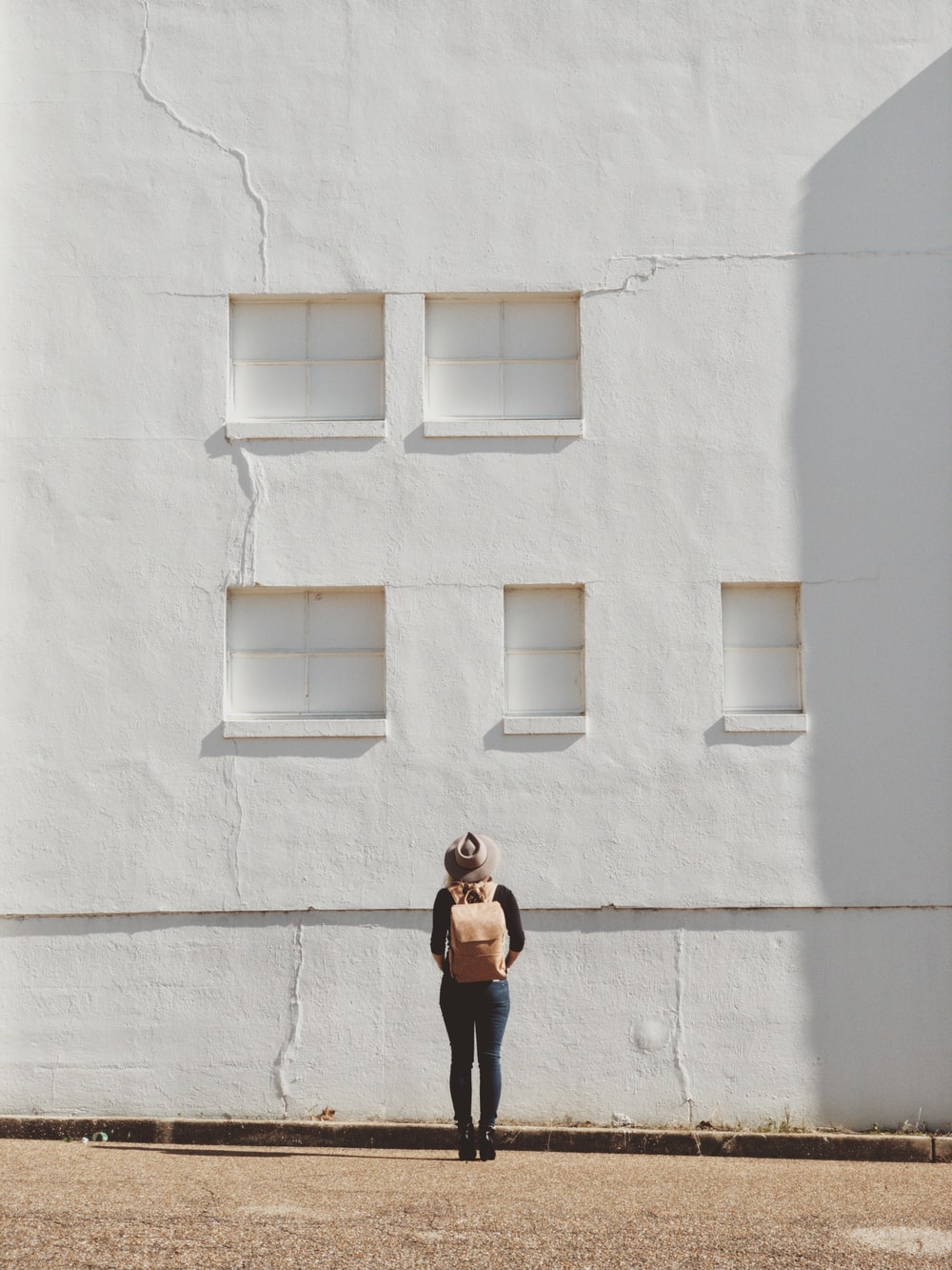 woman standing on front of white building
