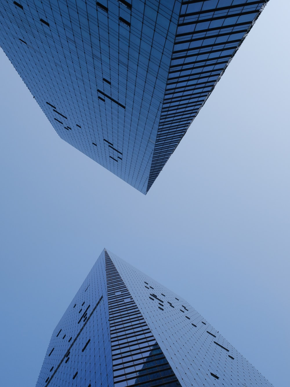 worm's eye view photography of two buildings
