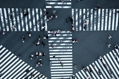 people walking on street asphalt zoom background