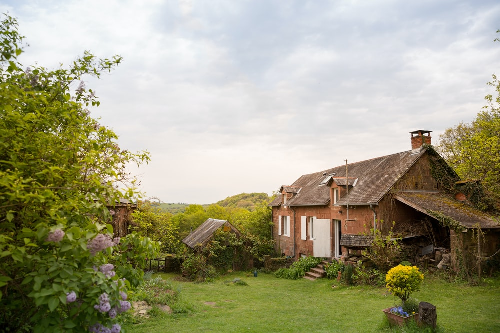 brown wooden house near at garden