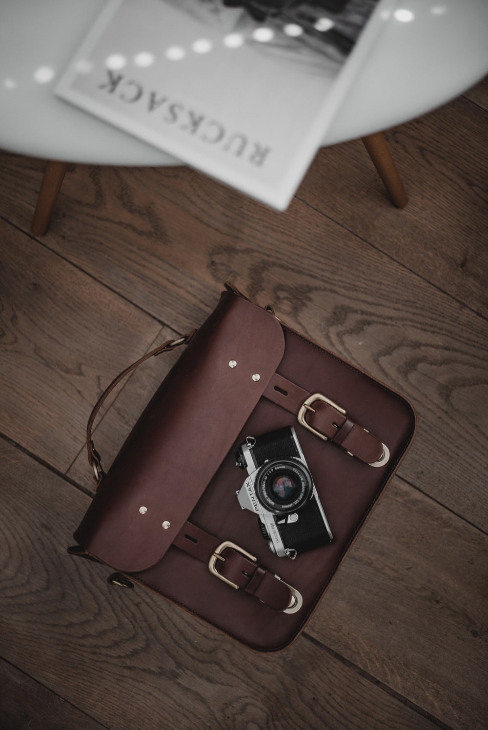 brown leather case on brown surface
