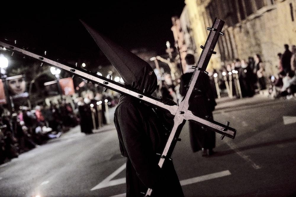 man carrying cross