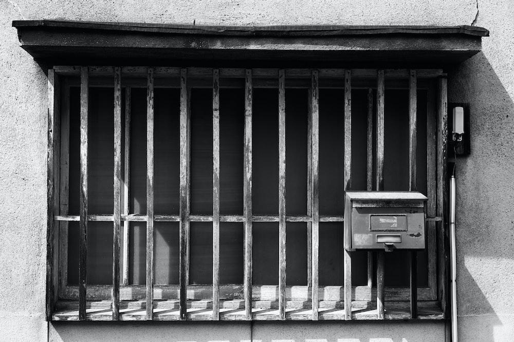 closed gray metal window grills