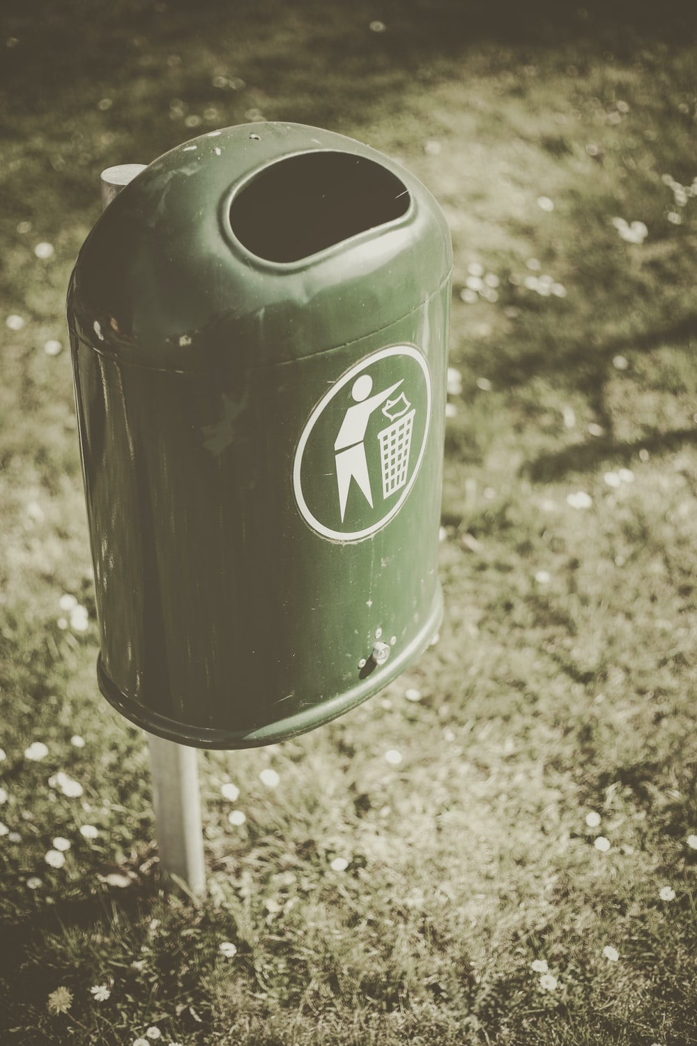 selective focus photo of green trash bin