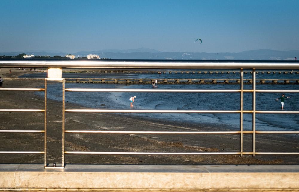 gray railings by the sea