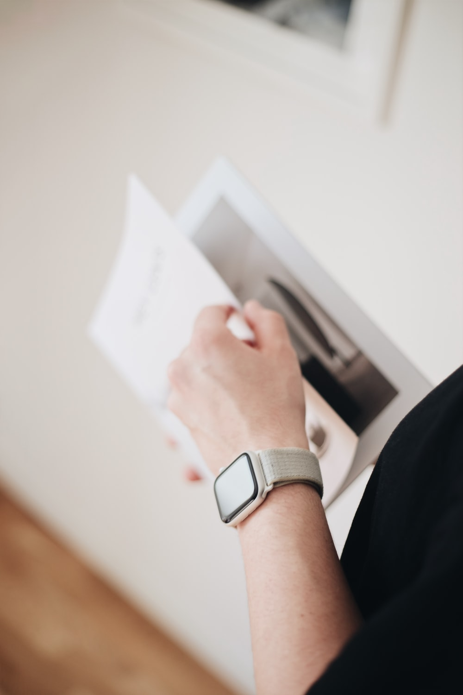 person holding white hardbound book