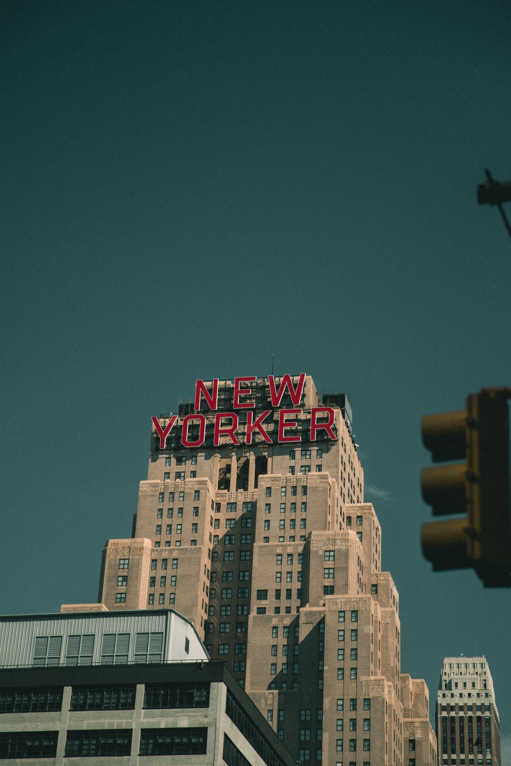 New Yorker signage mounted on building