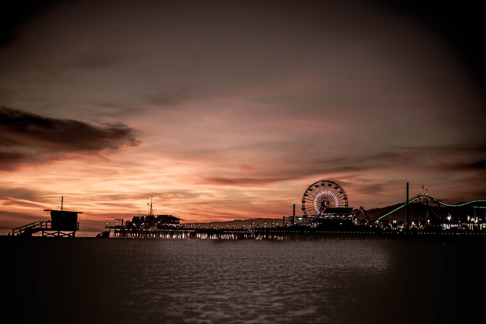silhouette photography of amusement park during golden hour