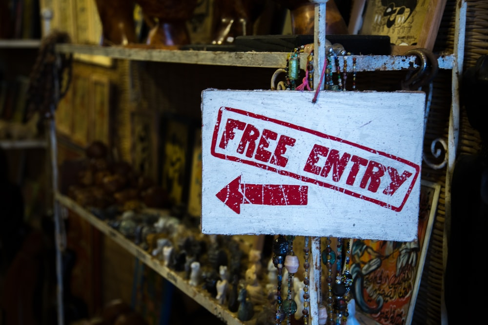 white and red Free Entry signage
