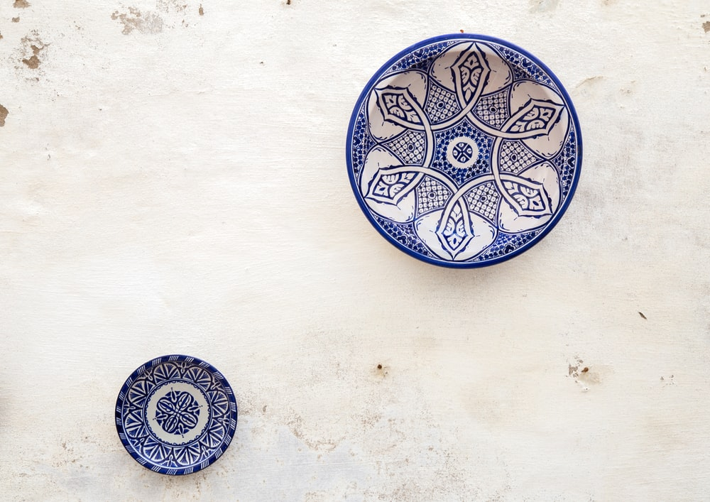 two white-and-blue ceramic dinnerware