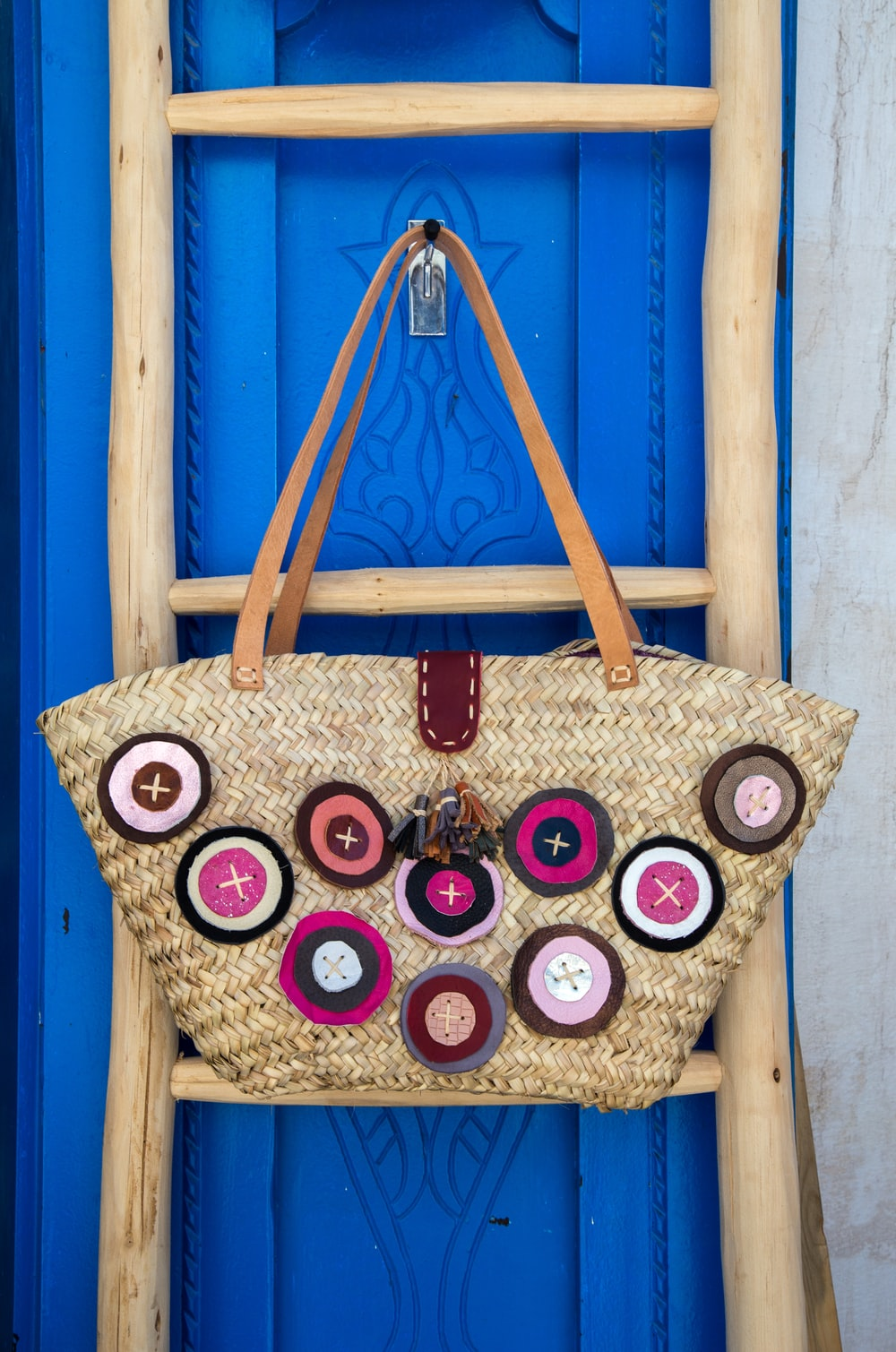 brown leather tote bag hanging on wall