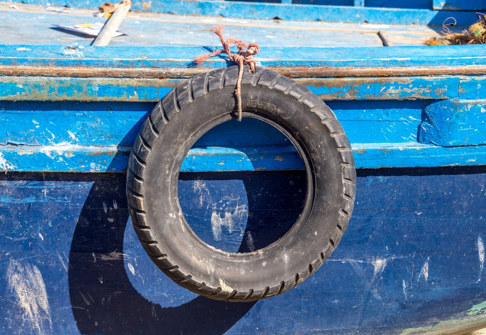 vehicle tire tied on boat