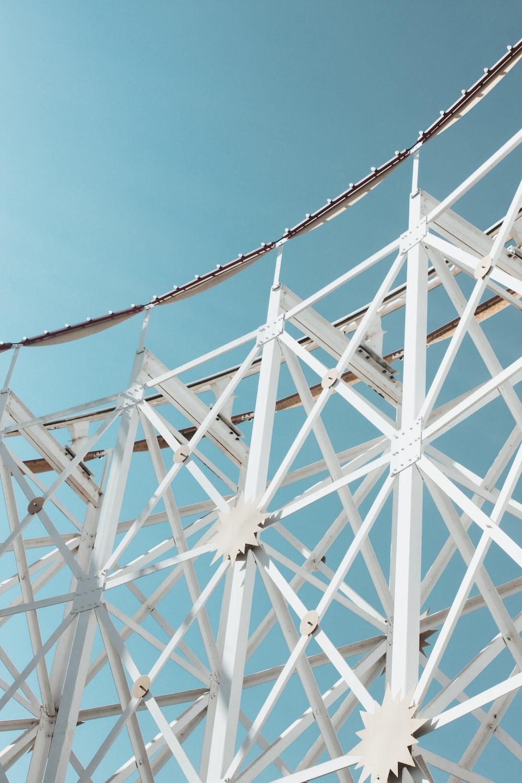 white metal frames under blue sky