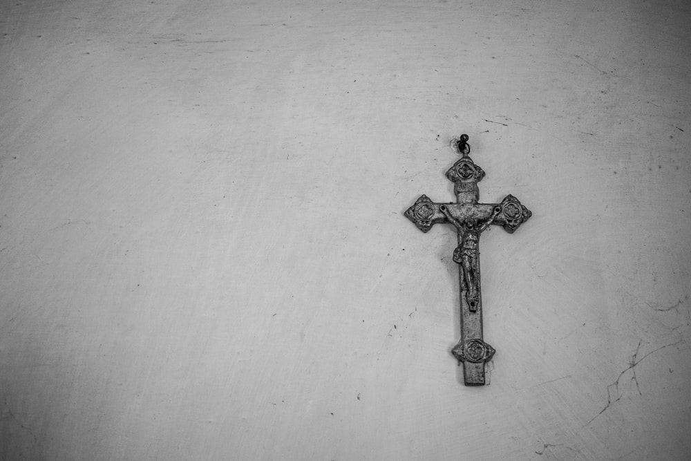 gray crucifix on wall