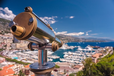 aerial photography of telescope overviewing city monaco teams background