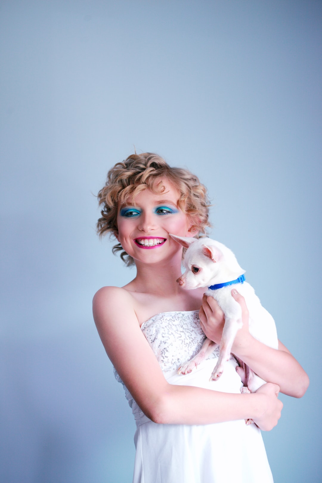 Bink, drag kid, with her chihuahua.